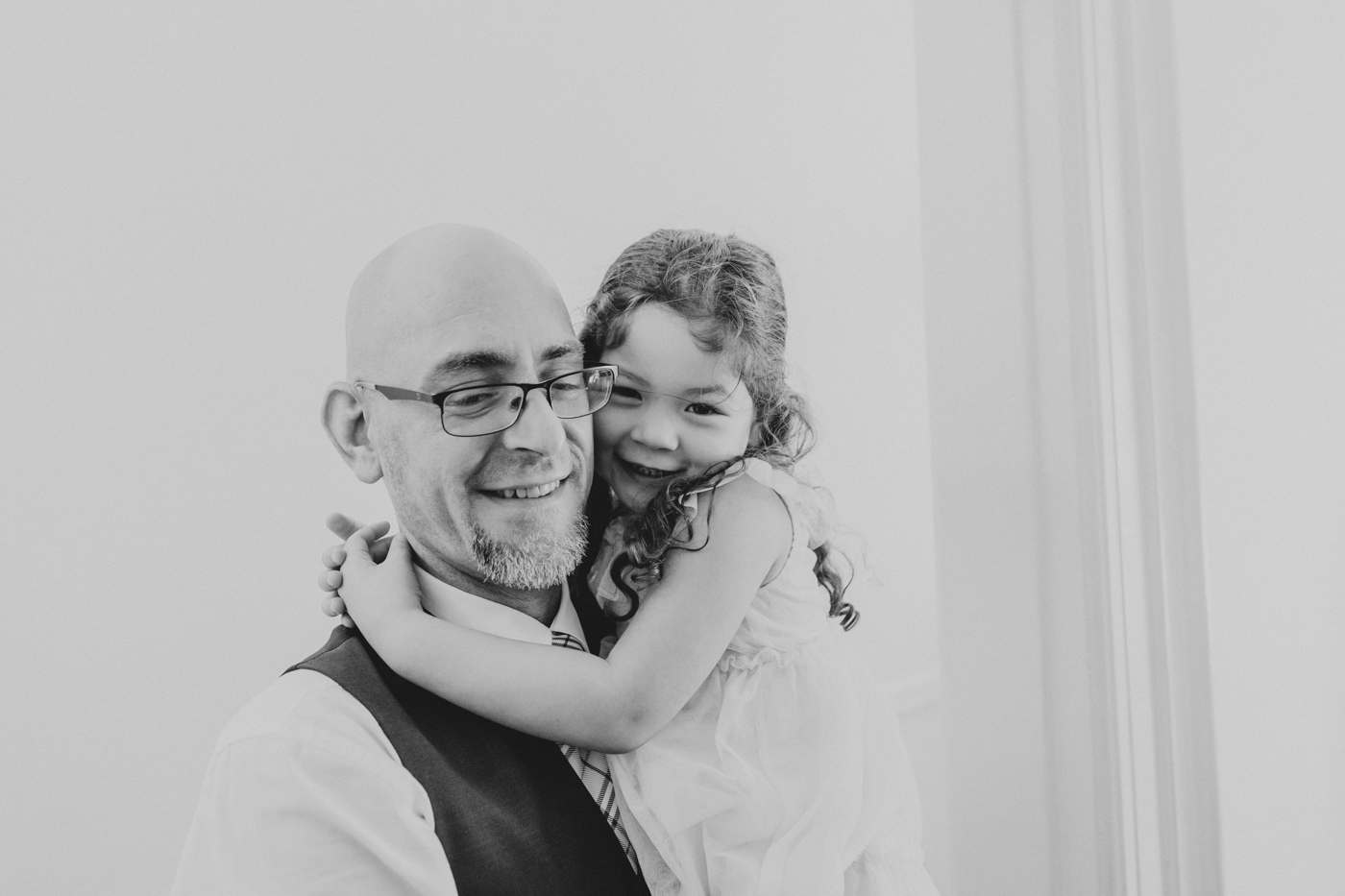 father-holding-smiling-daughter