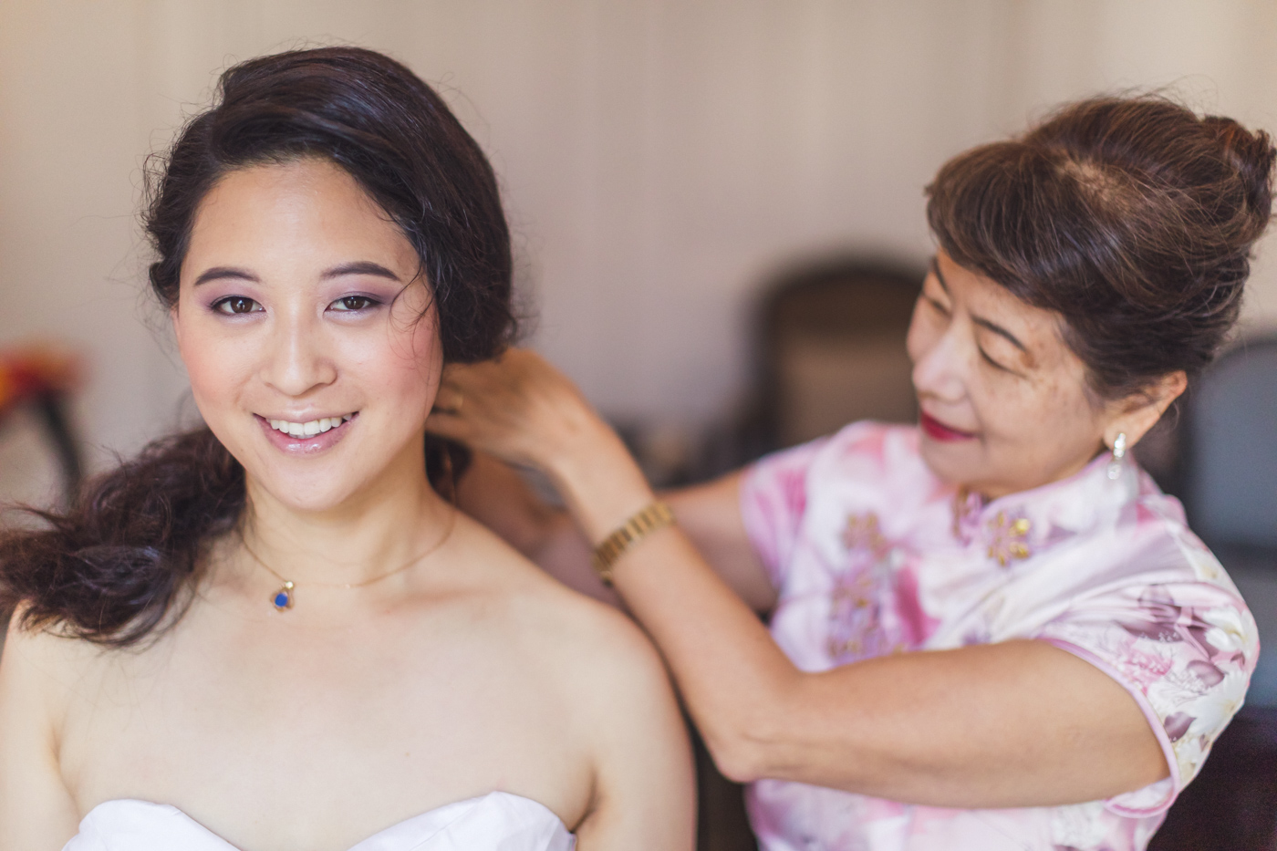 sf-bride-getting-necklace-put-on-by-mom