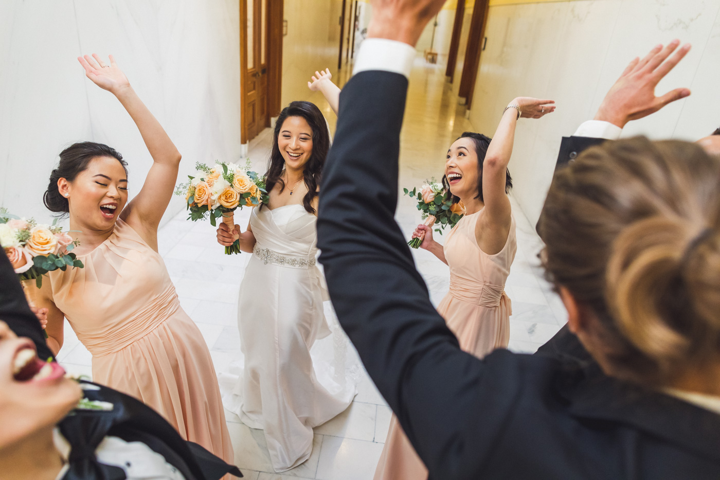 wedding-party-high-fiving