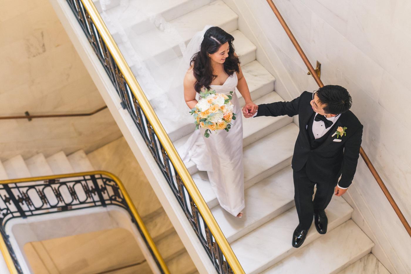 bride-and-groom-walking-down-stairs