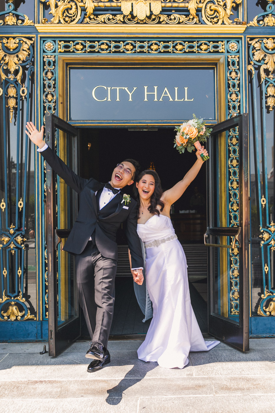bride-and-groom-exiting-sf-city-hall-happy