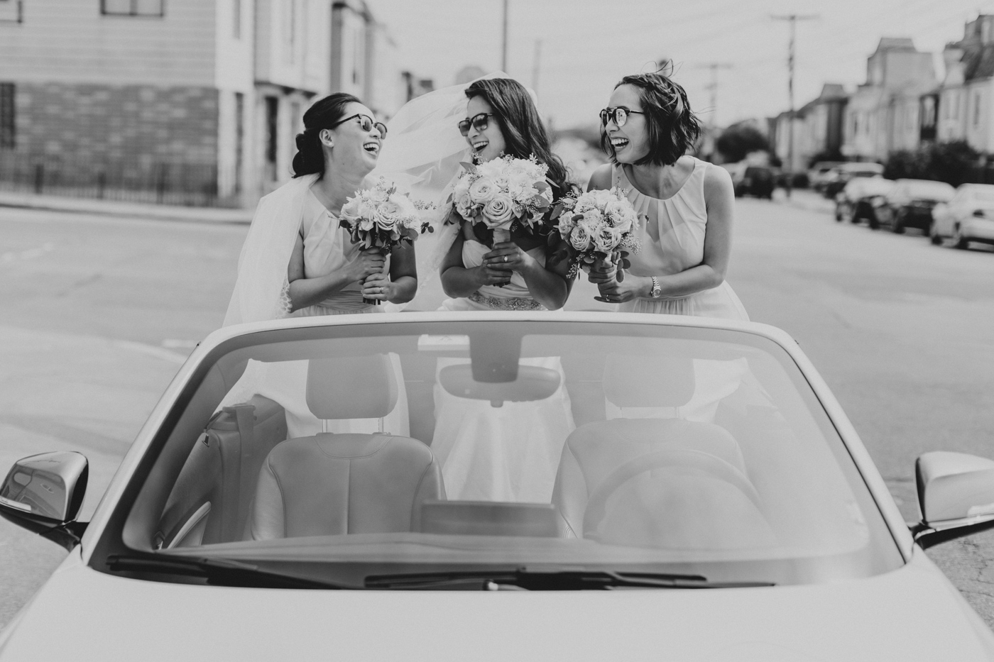 bride-and-bridesmaids-in-convertible