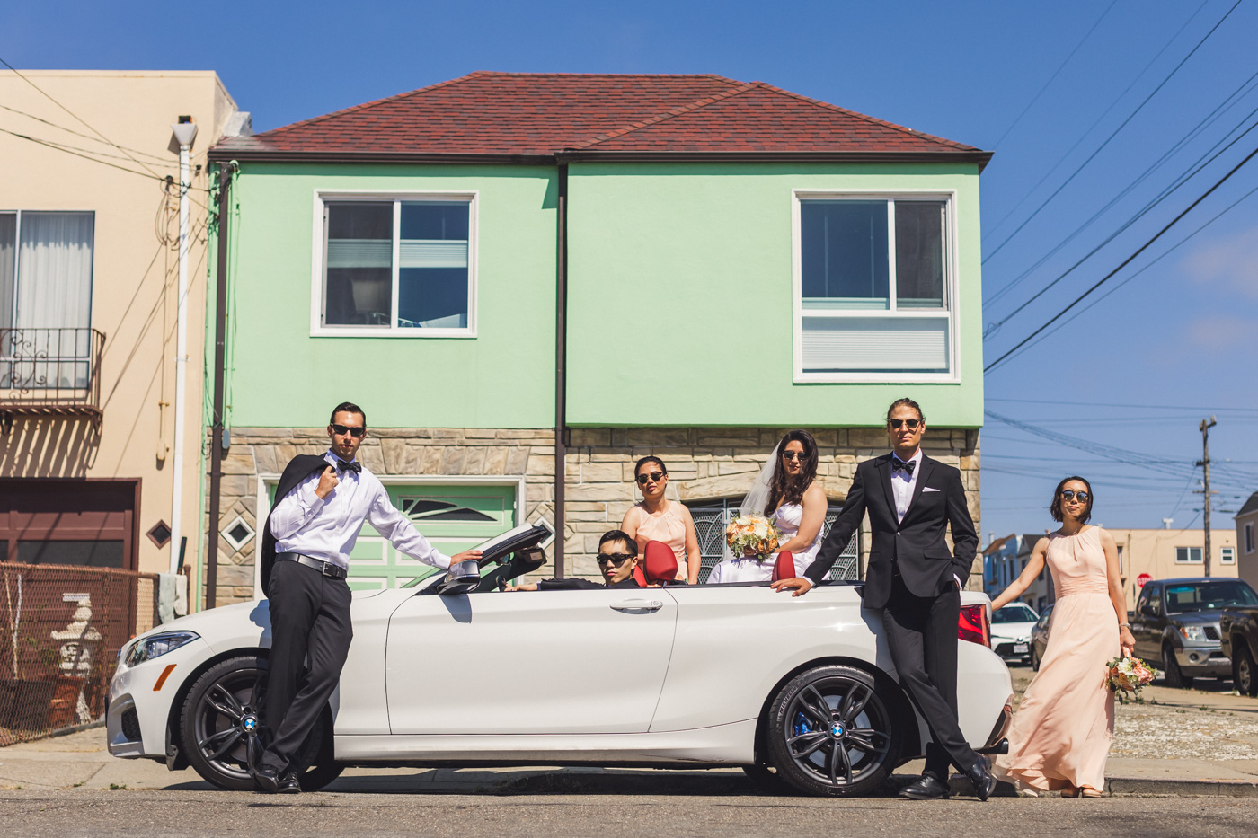 wedding-party-group-photo-in-convertible-san-francisco