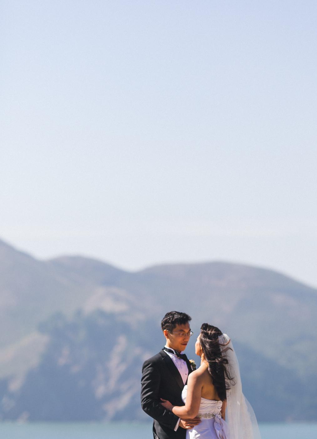bride-and-groom-wedding-portrait-by-ocean