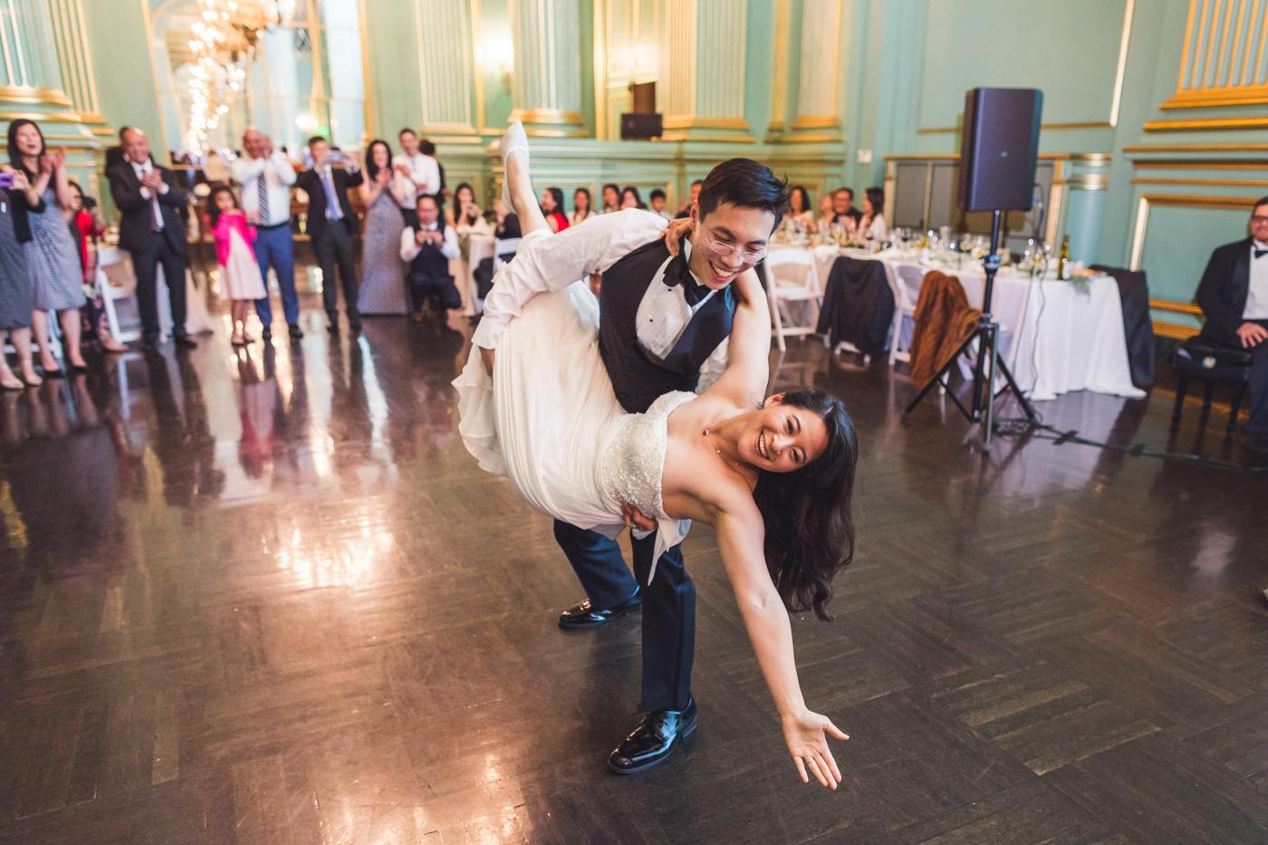 groom-dips-bride-first-dance-green-room-wedding-reception