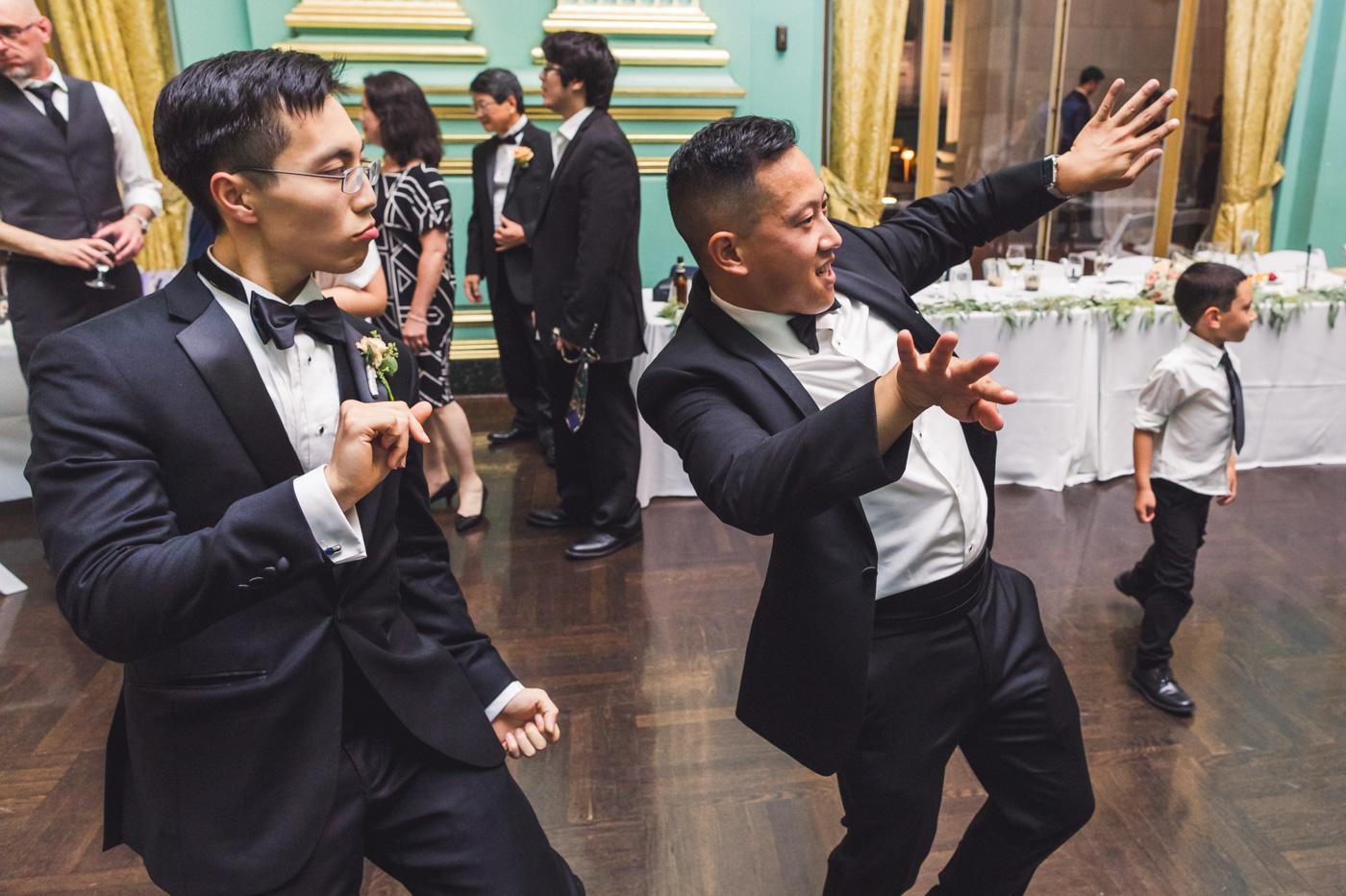 groom-and-groomsman-dancing