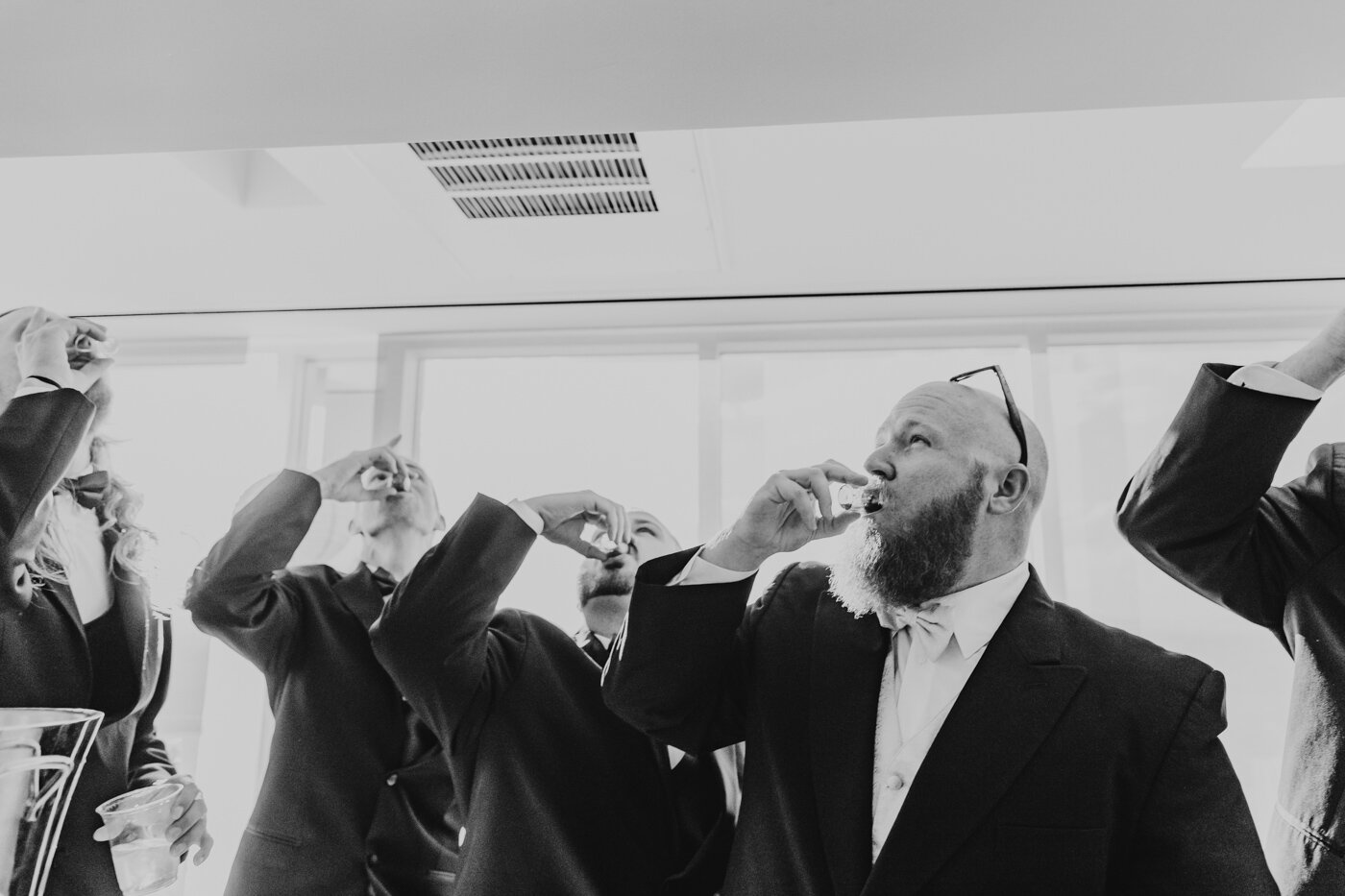 groom-taking-shots-with-groomsmen