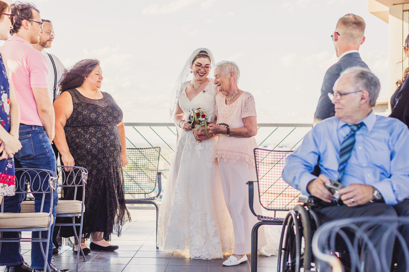 bride-and-grandmother-walk-down-aisle
