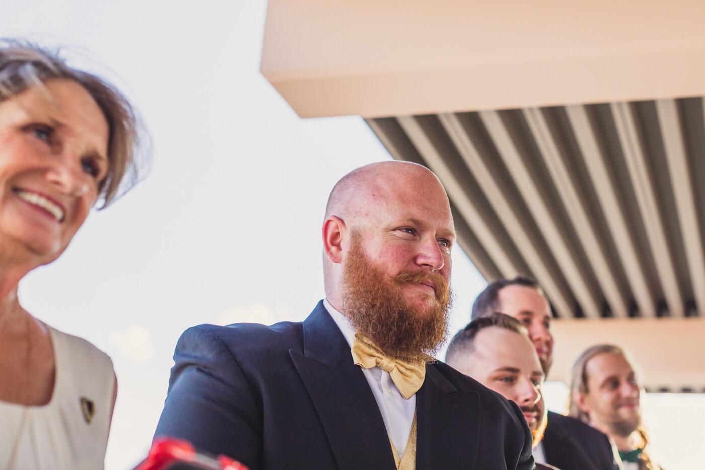 groom-watching-bride-walk-down-aisle
