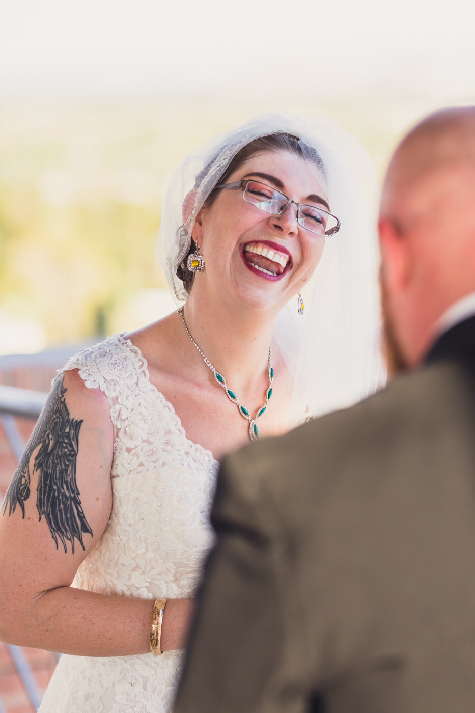 bride-laughing-during-ceremony