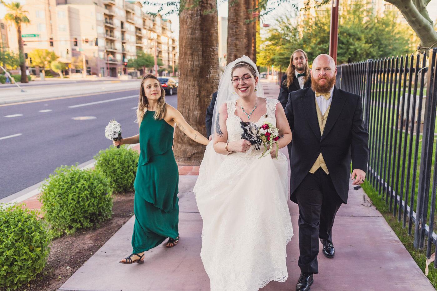 wedding-party-walking-down-phoenix-street