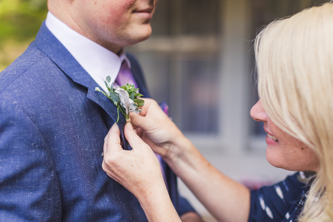 groom-getting-boutonniere-put-on
