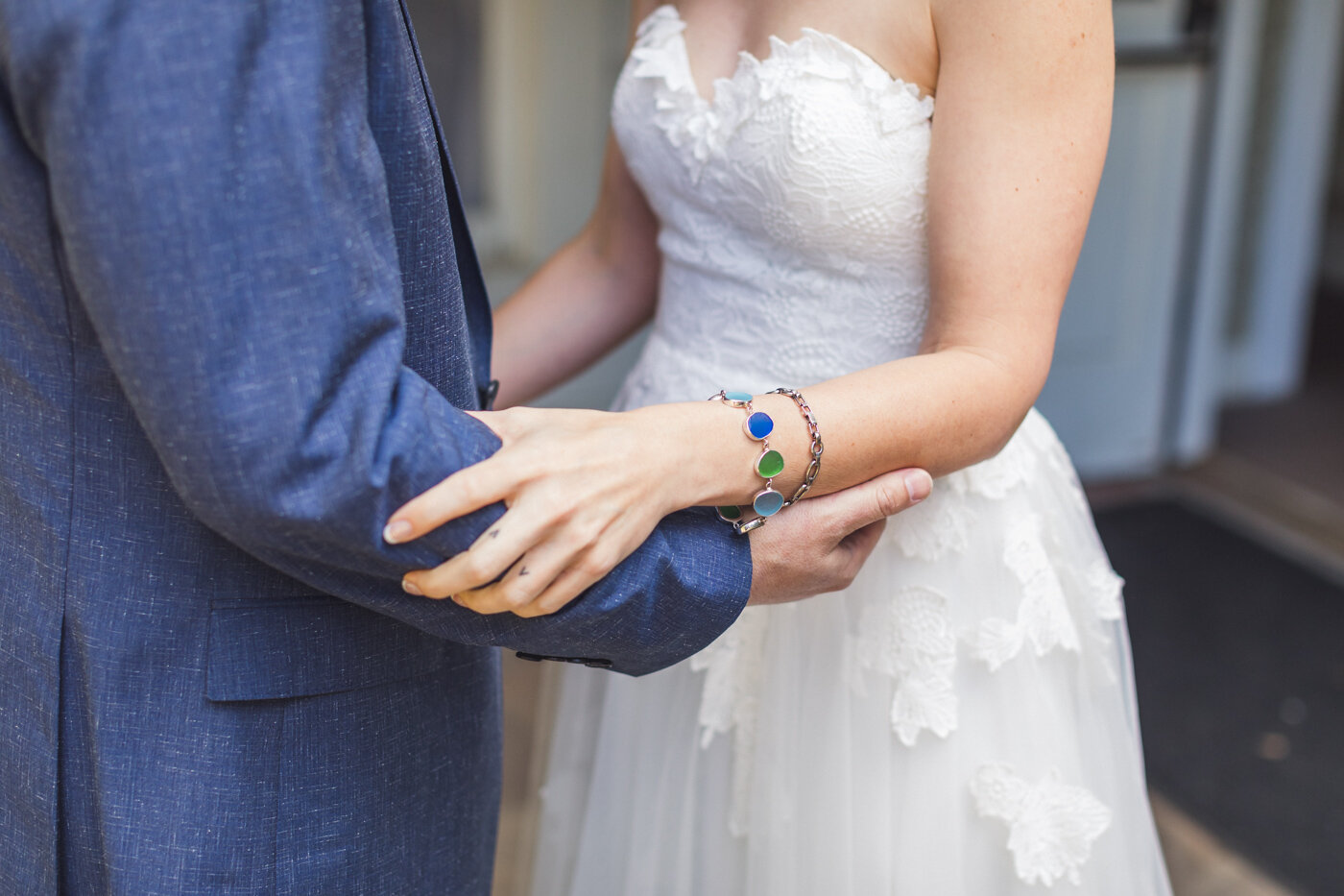 bride-and-groom-holding-arms