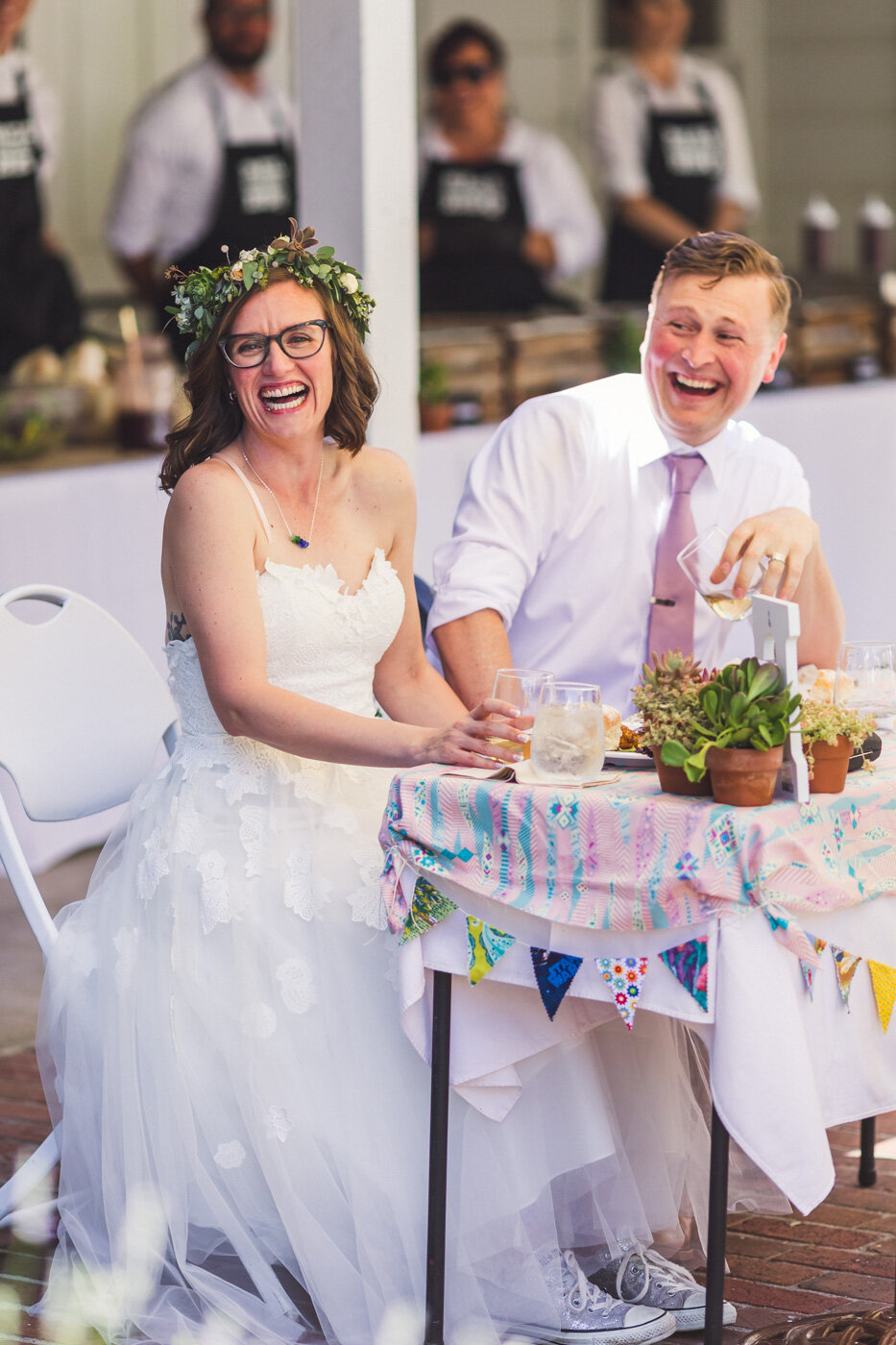 bride-and-groom-laughing-during-speeches