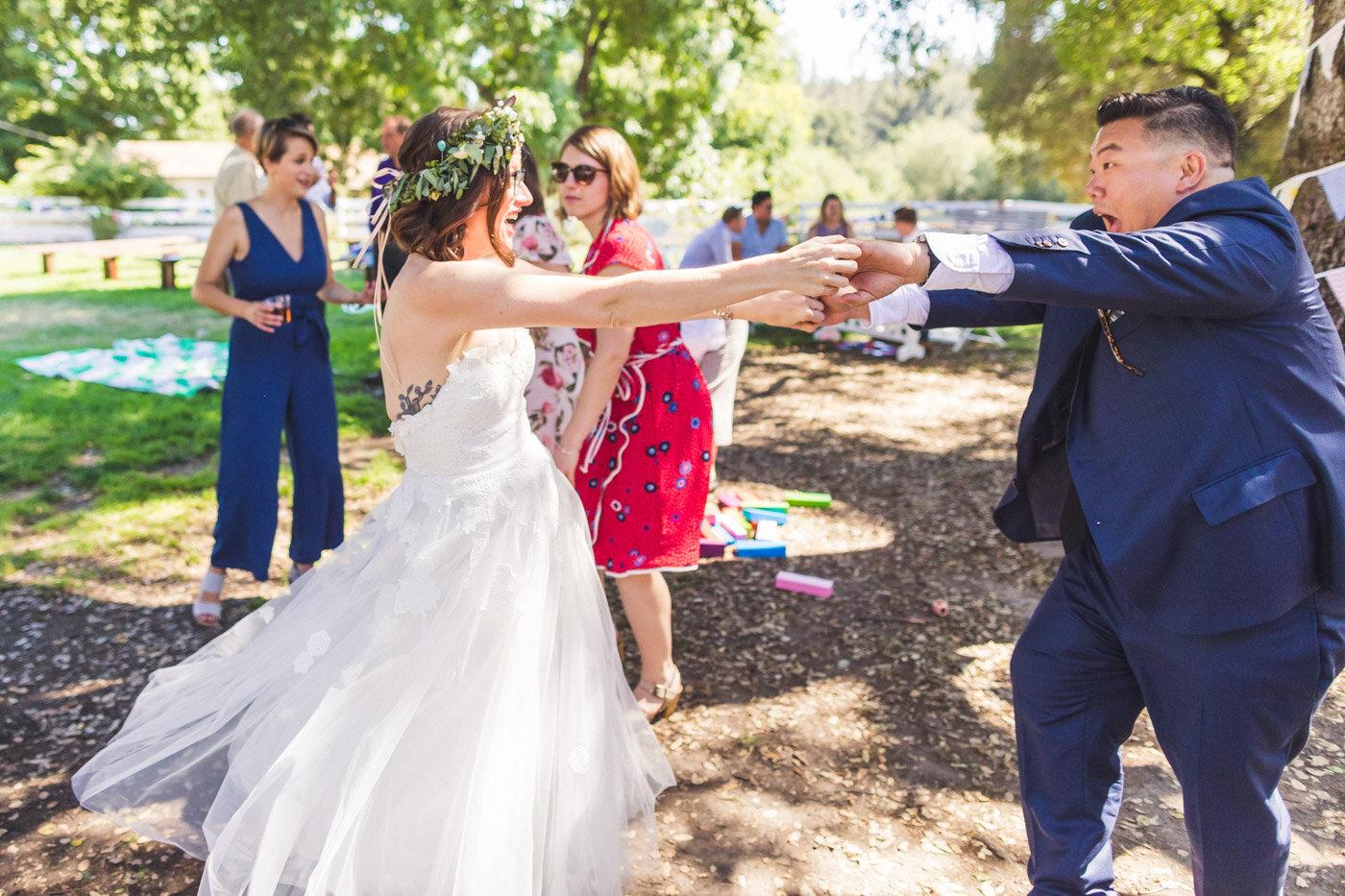 bride-getting-twirled-by-wedding-guest