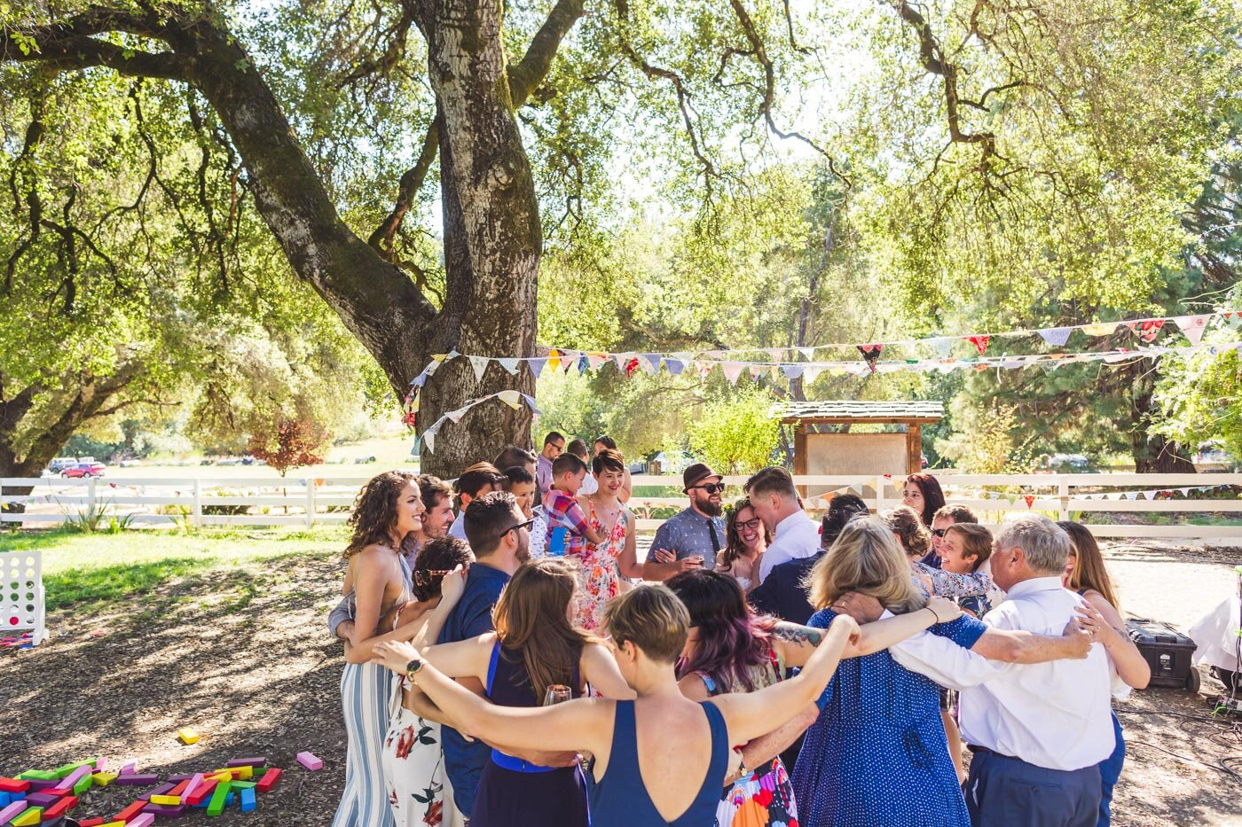 friends-and-family-surround-bride-and-groom-dancing