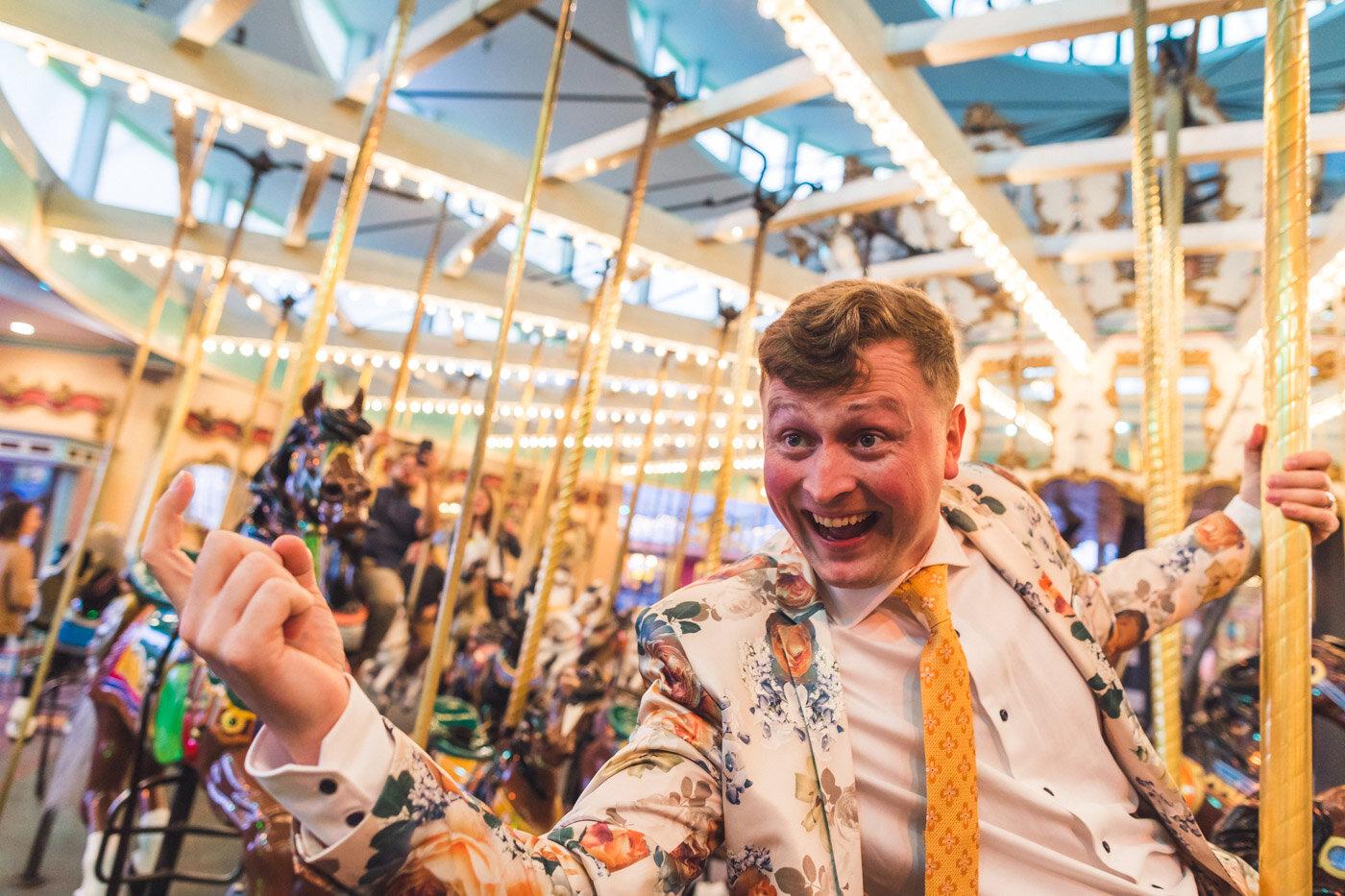 groom-on-carousel