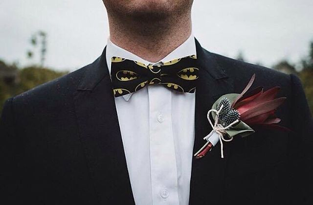 It's awesome seeing our bow ties in their natural habitat. This custom Batman piece was captured by @cjwilliams_photography at the wedding of Tim and Emma just before he punched The Joker in the face. Congrats!