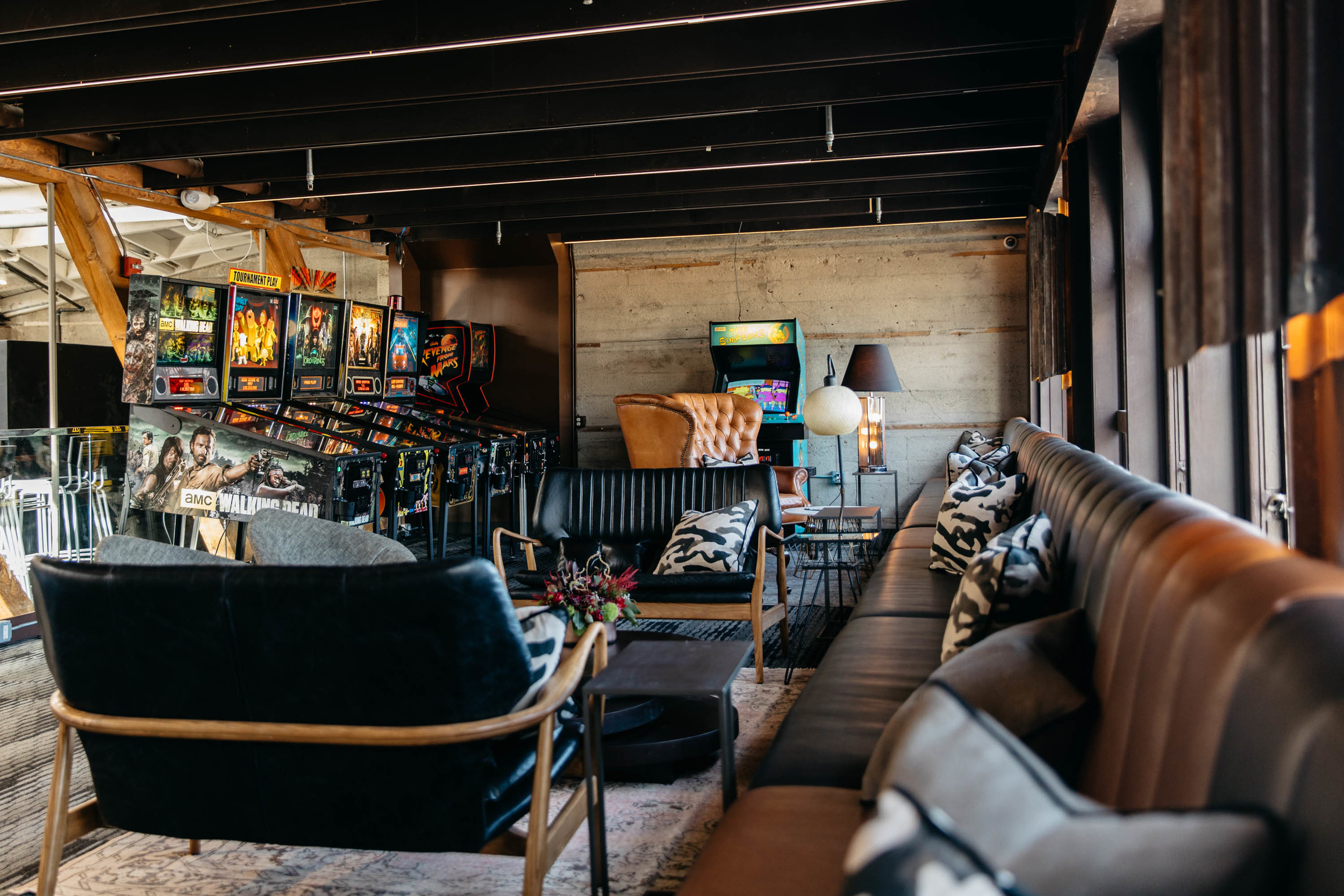 "We love how there isn't a separate between ""arcade area"" and ""lounge area"" but it's all incorporated together."