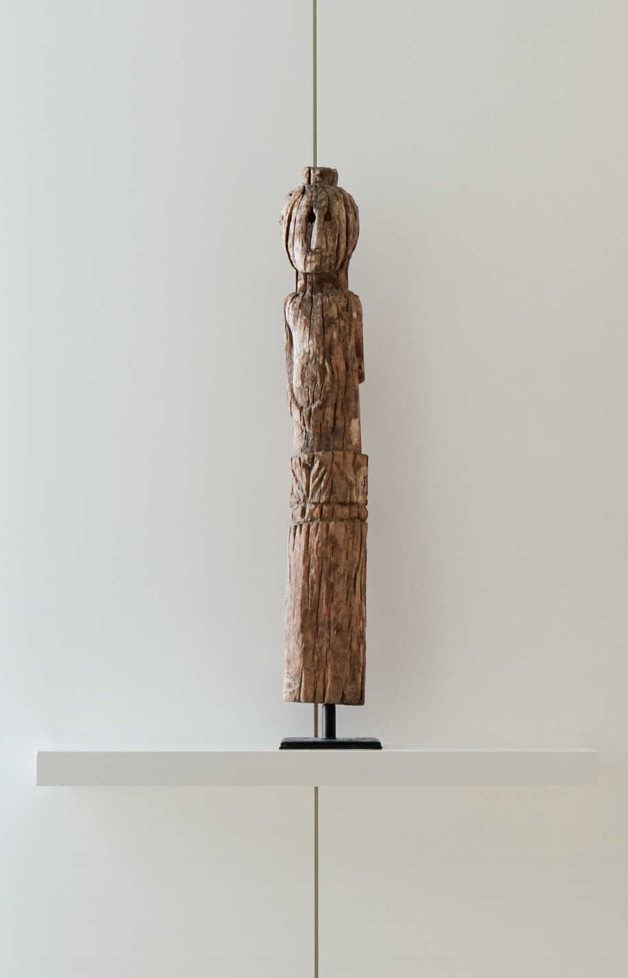 A carved wood ghost sculpture from Bali.
