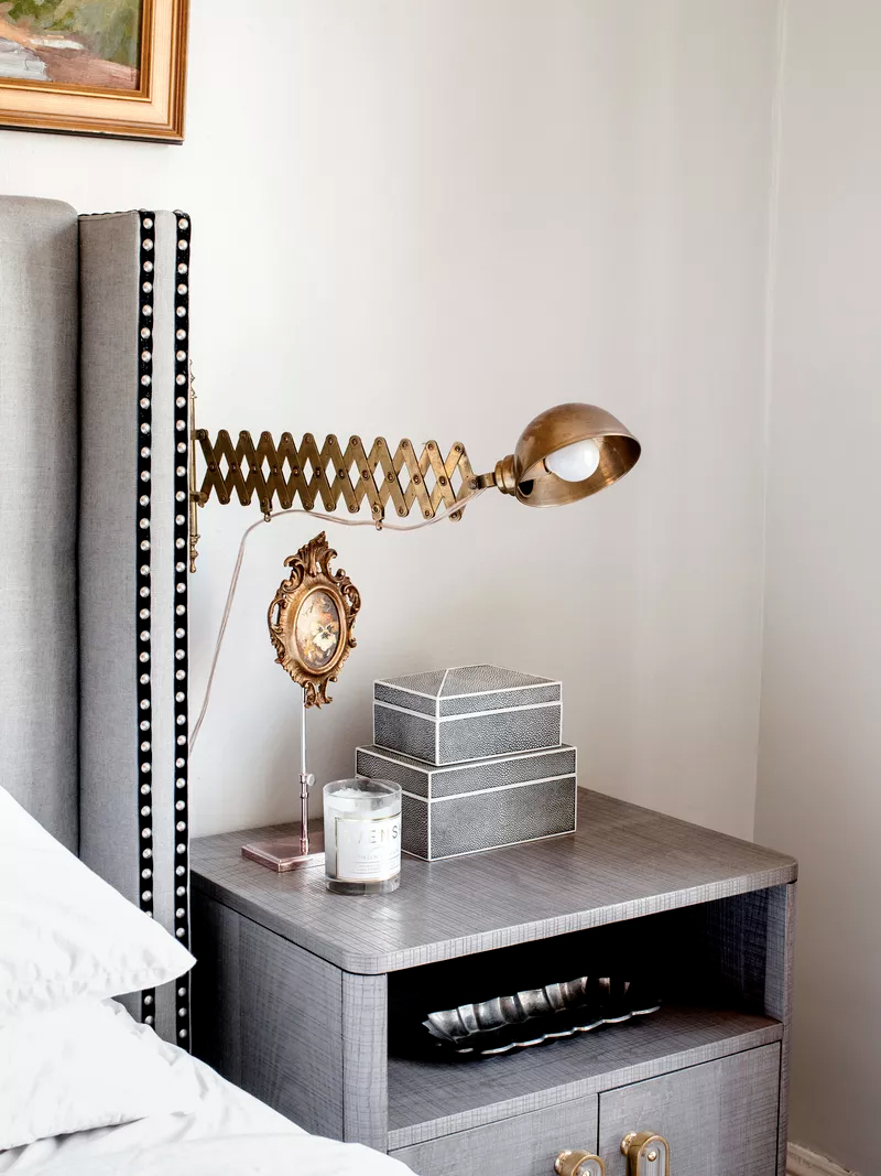 Alicia designed this headboard with ribbon and nailhead trim. The bedside light fixture is from  Hesperus Nautical , the nightstand is from  Anthropologie .