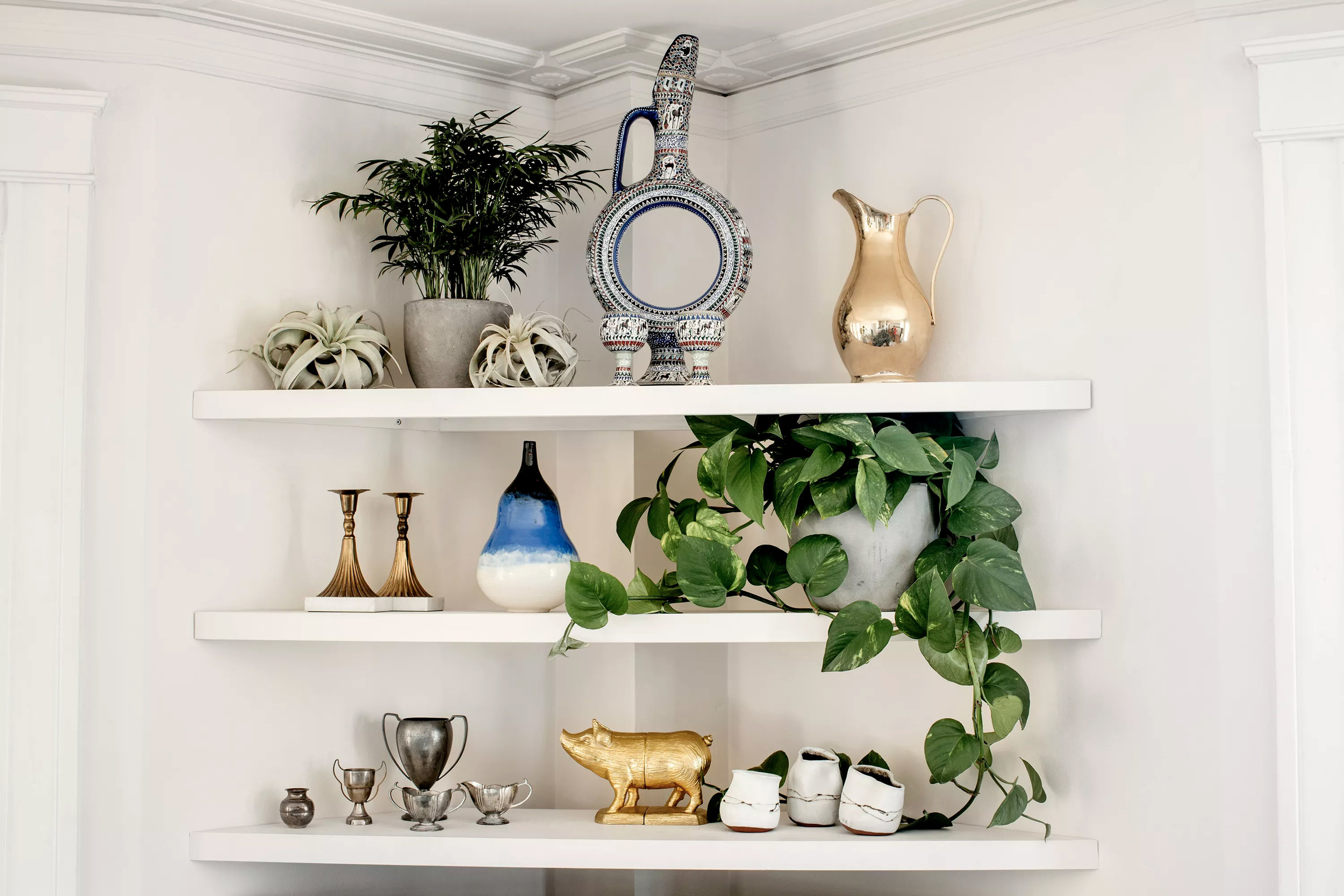 Alicia designed and installed a set of corner shelves that serve as a display area.