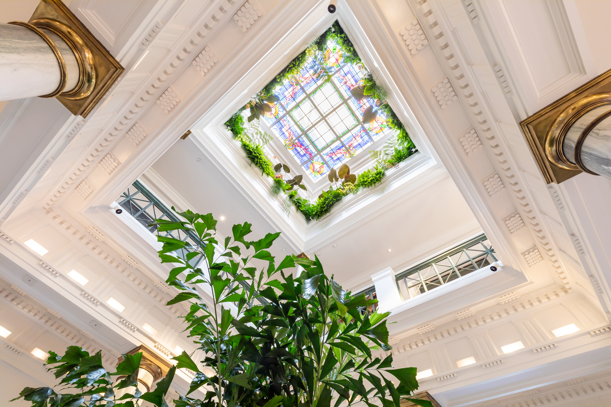 "The home's rotunda with ""the Balcony Garden: the Skylight Conservatory"" by  Brandon Pruett Design"