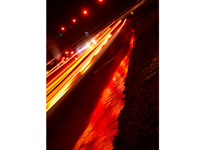 ...shot along Kirkwood Highway when I went to run a family errand one night. The tail lights and stop lights are lighting up an ice patch bright red, like a hot lava flow.