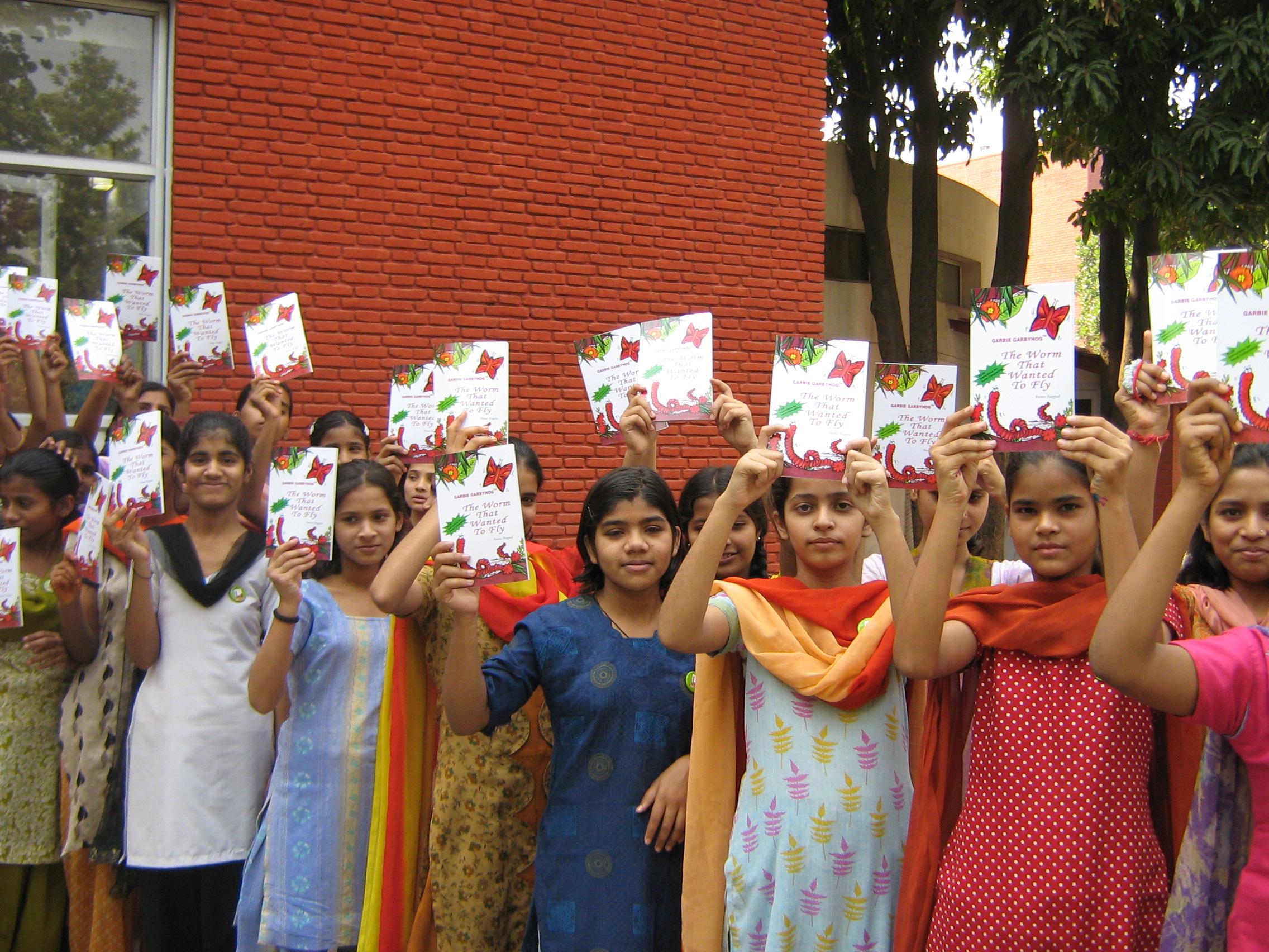 children holding gbh book.jpg