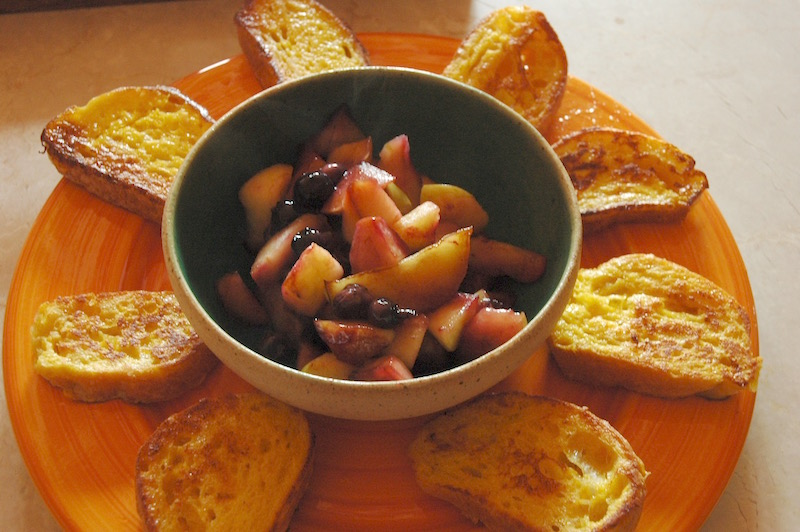 French toast served with mulled peaches and blueberries