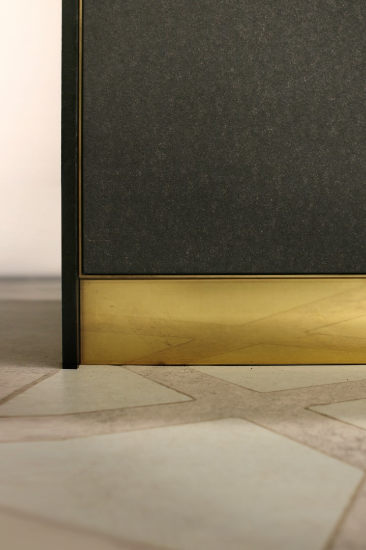 Anitcato stone flooring with oak desk and brass detail.