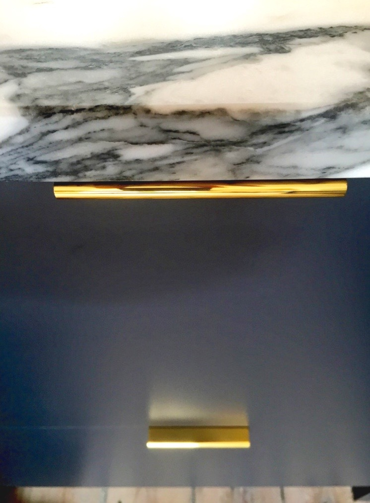Detailing brass cabinet handle for kitchen draw