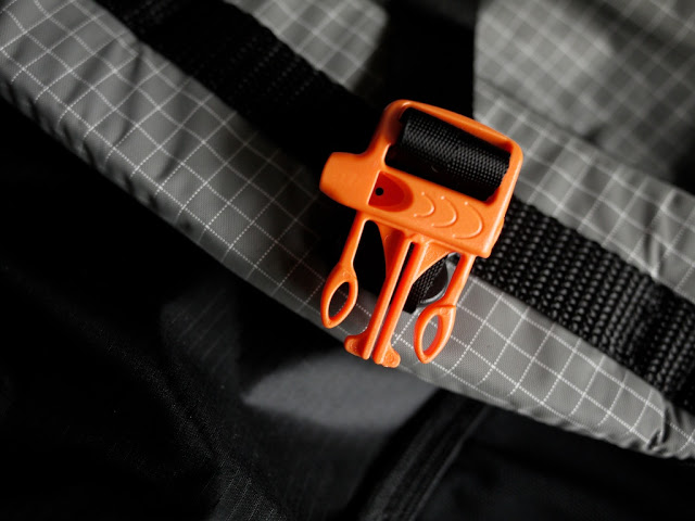 An emergency whistle incorporated into the sternum strap of the 2012 Gossamer Gear Mariposa - a handy multi-use feature, but remember to add a whistle to your first aid pack if you remove the sternum strap.