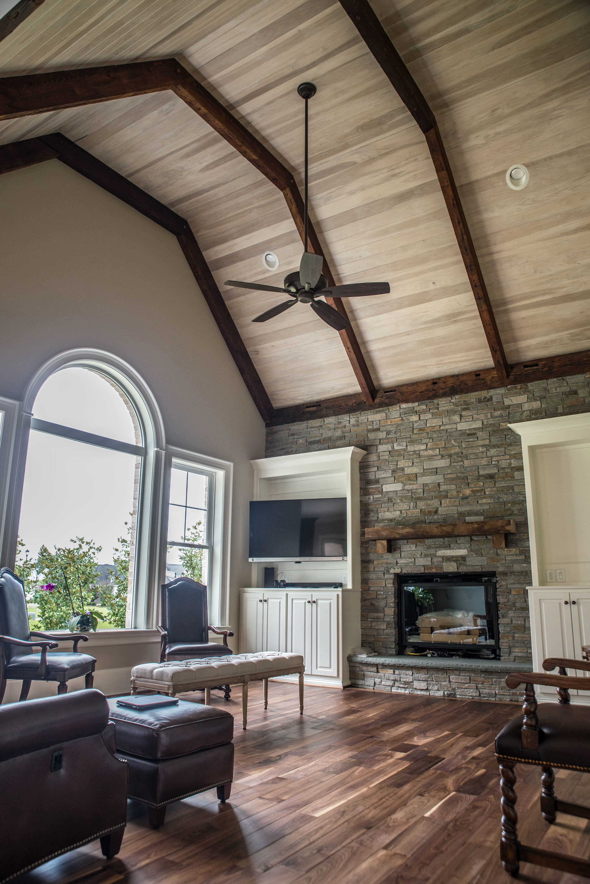 Custom Walnut Flooring with Antique Beams and Ceiling Panelling