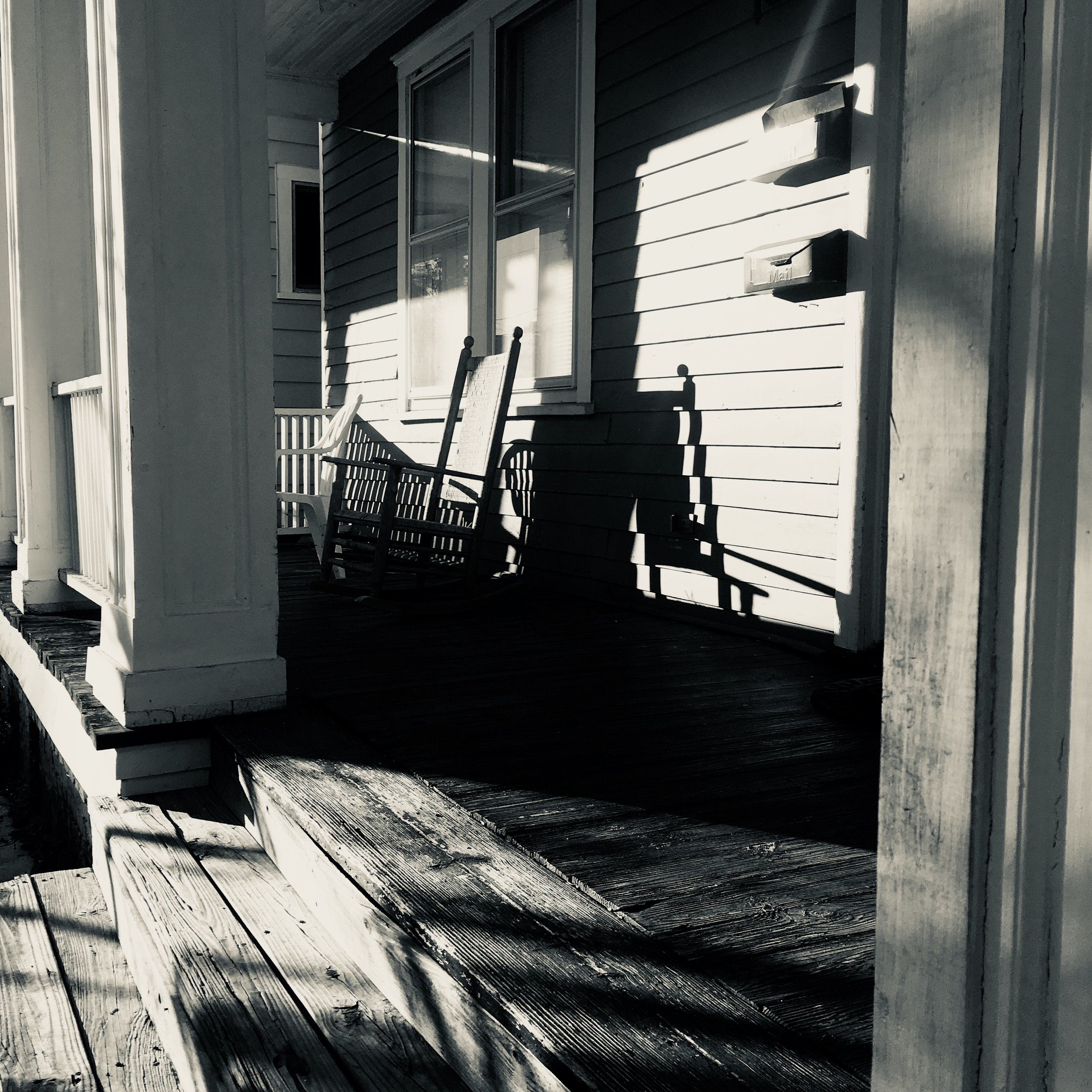 Classic end of the day, sun going down, empty porch rocking chair shot.