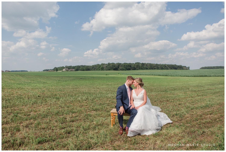 meghan marie studio ohio wedding kyle ahrens msu michigan state basketball spartans navy blush rustic barn soft warm bright bubbles catholic church_0408.jpg