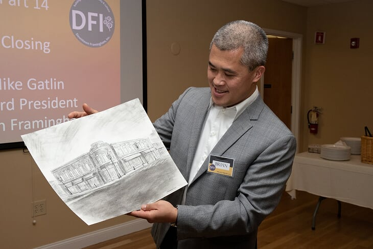 Downtown Hero Brian Li admires a live sketch of his property, the Bullard Building, by artist Jason Cheeseman-Meyer