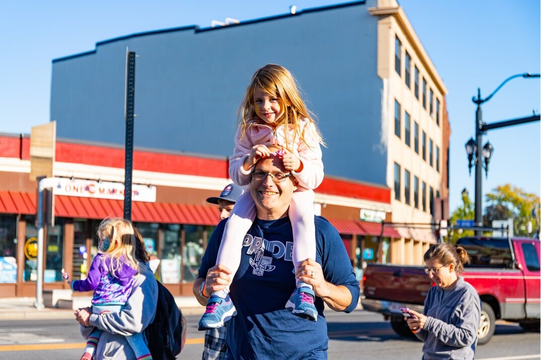 DFI Board Director Adam Blumer enjoying Burkis Square with family at Oktoberfest. Photo credit Itala Keller.