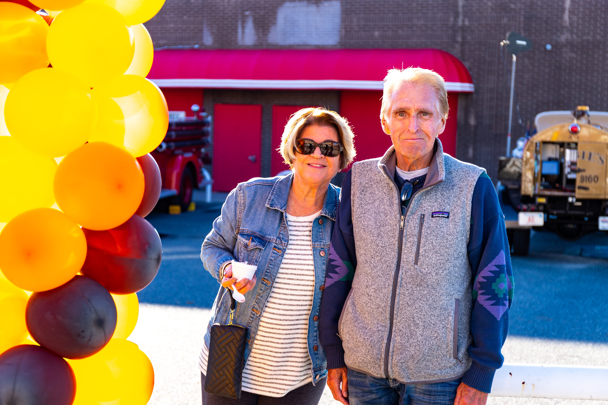 A young couple enjoys the colorful balloons in Burkis Square, compliments of Cristina's Decorations at 62 Hollis Street! Photo credit Itala Keller.