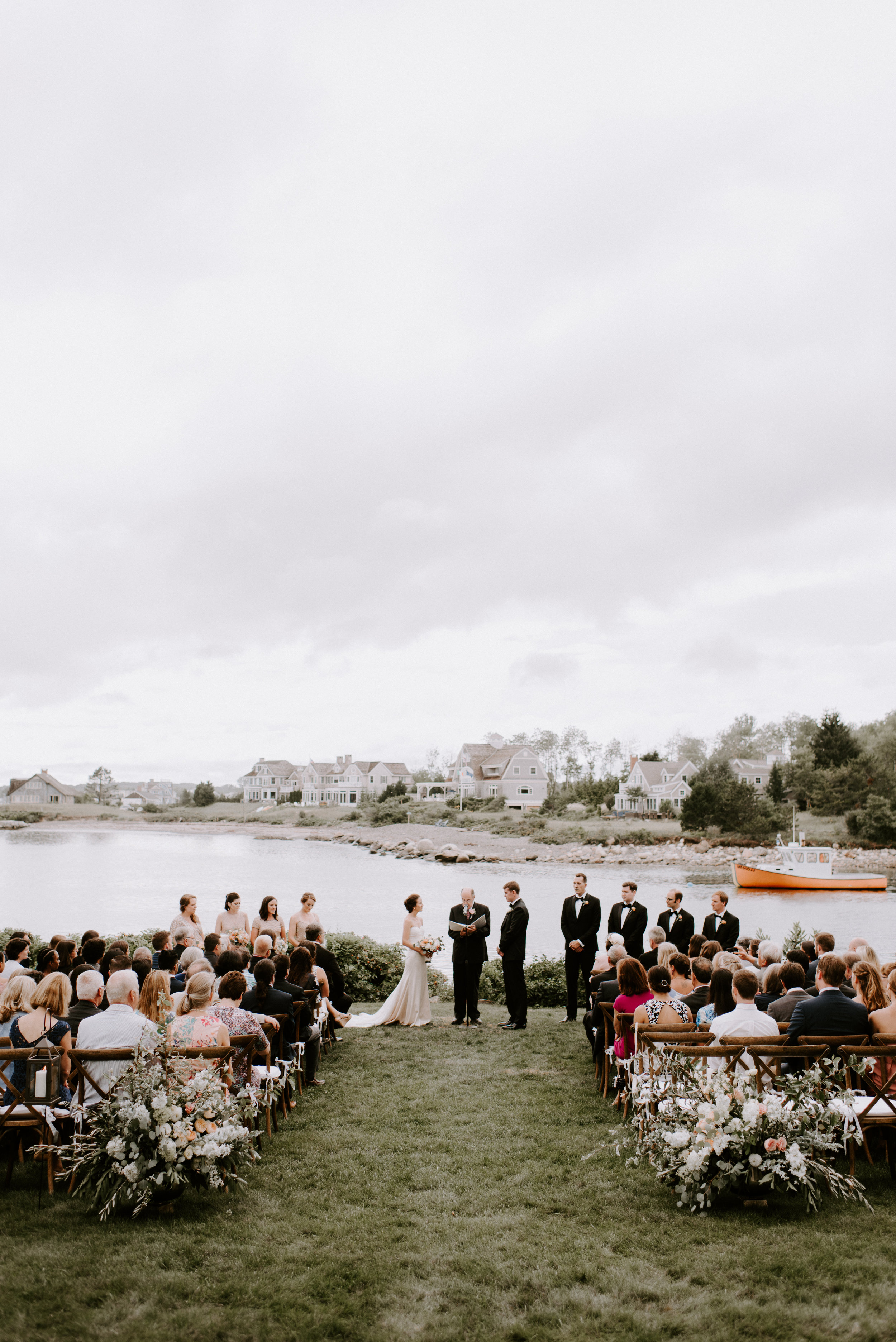 Nothing beats an ocean backdrop and the sophistication of black tuxedos.