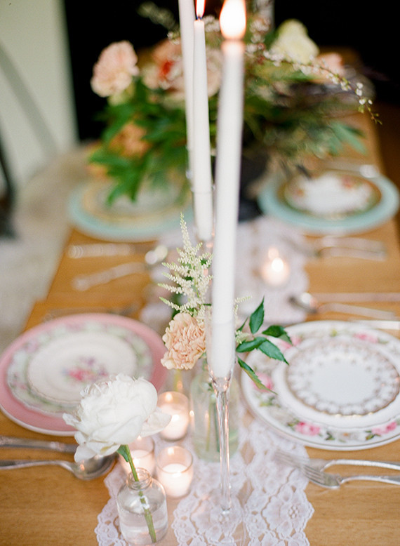 A little lace, a lot of bud vases, tea lights, vintage china an flatware... What is more to love?