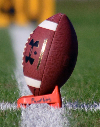 The ban, which will take affect in the three youngest divisions when the season begins this fall,
