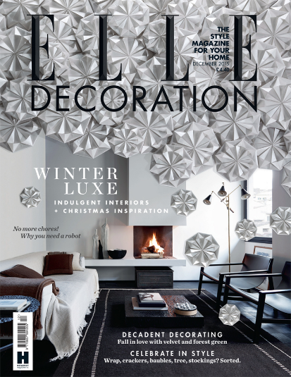 A cascading avalanche of hand-folded flowers for Elle Decoration's December 2015 issue.