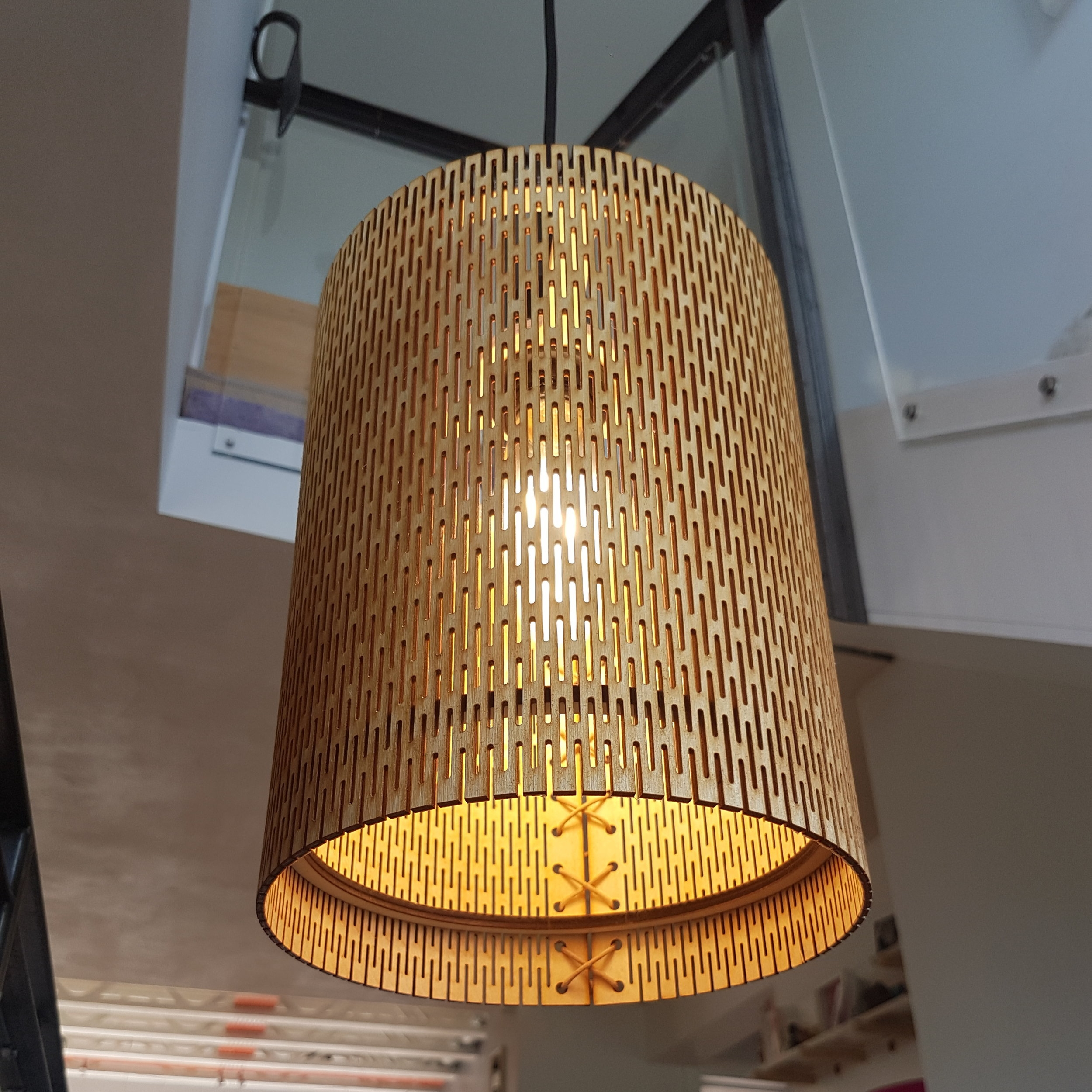 LYNN STONEHOUSE     Plywood lampshades finished with leather cord. Made in Cornwall.