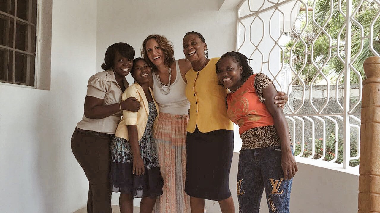 Me, present day, with some of my most beloved and incredible Jasper House Haiti staff members, all of whom I know and love dearly!