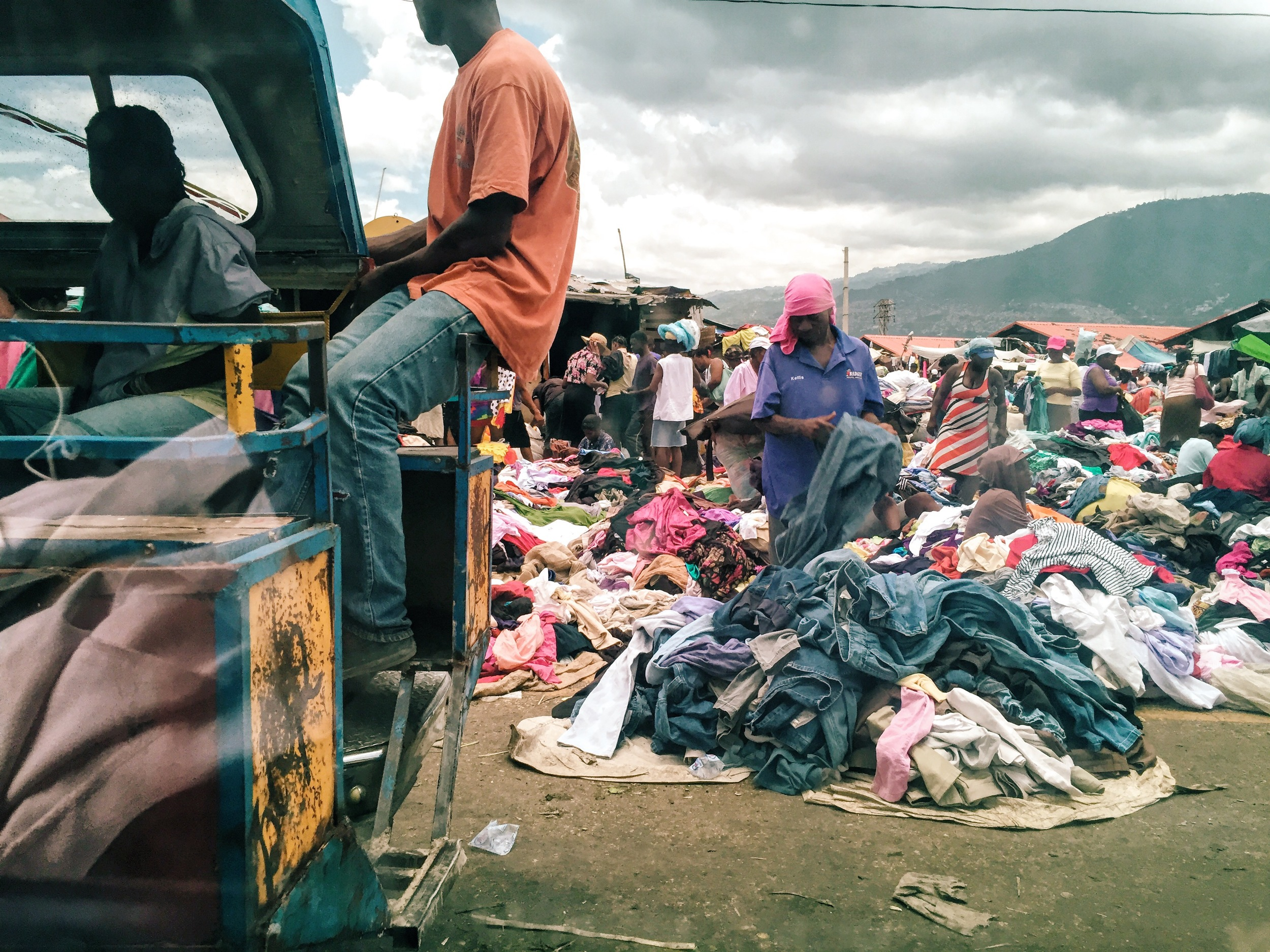 A local market in downtown Port-au-Prince, where a man sifts through a pile of secondhand clothing.