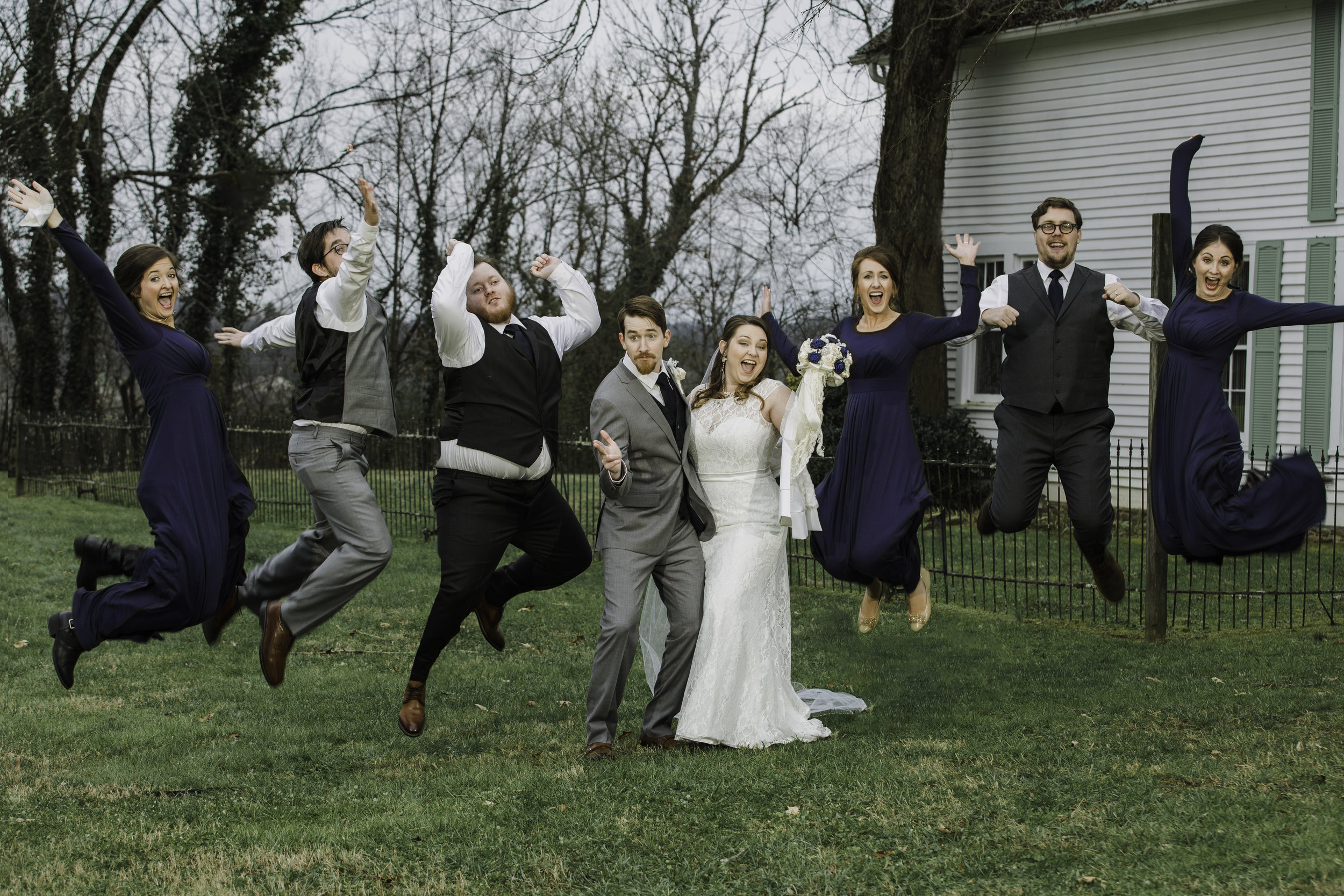 Did everyone jump at the same time?  No.  Did everyone execute a perfect jump?  No.  Could I take the best of three photographs and make this image for the couple's album?  Yes!