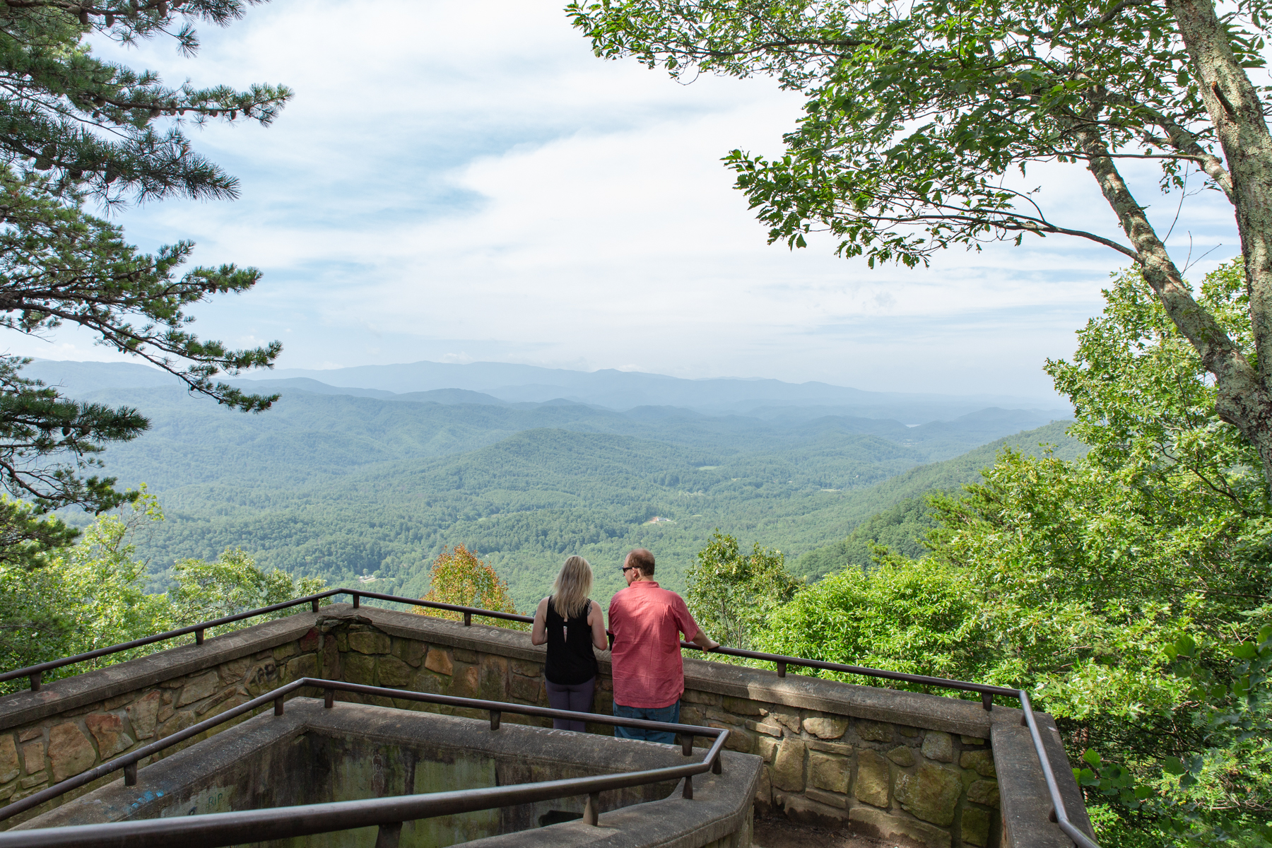 The unsuspecting bride enjoys the view of the Smokies from Look Rock on the Foothills Parkway