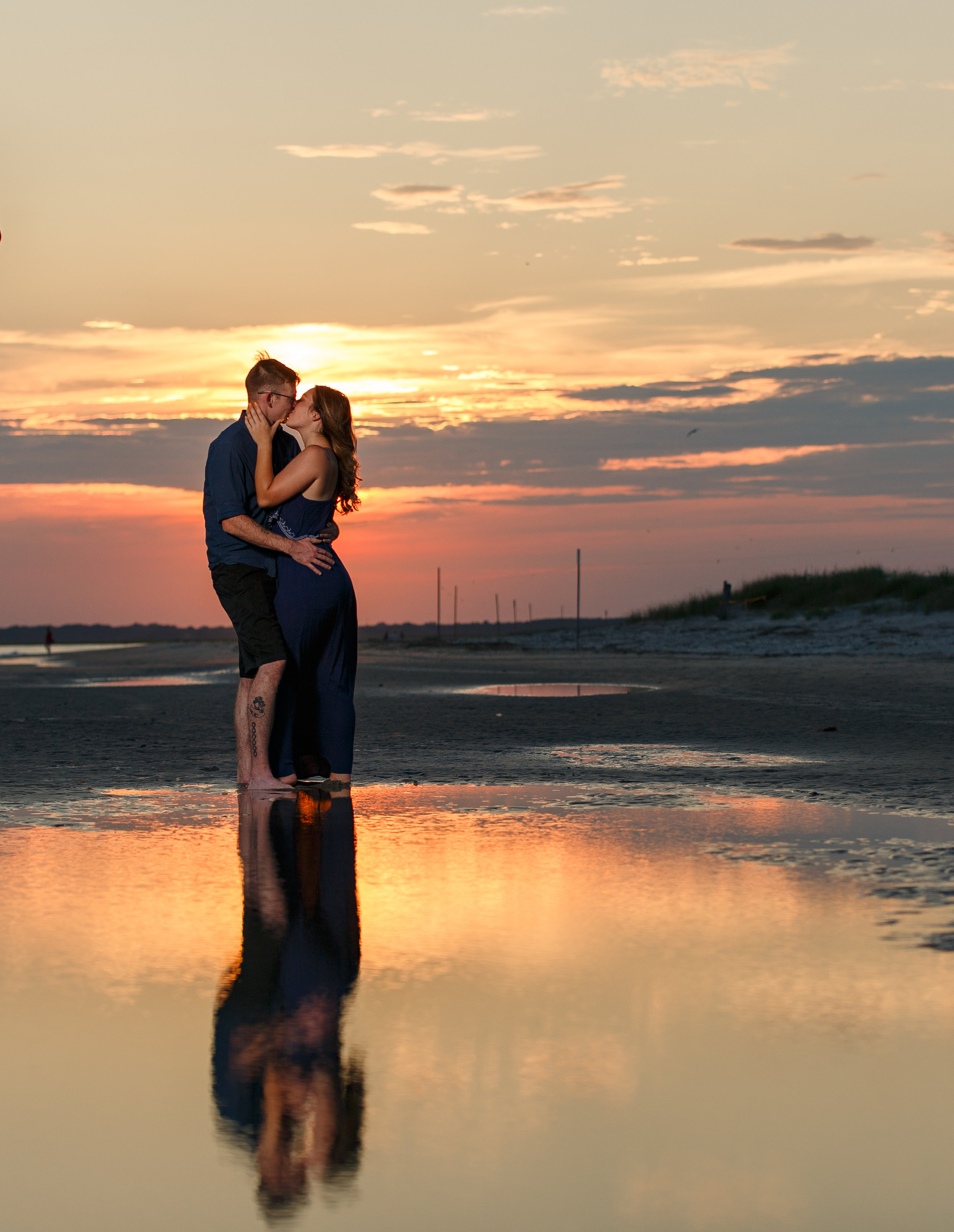 Couple With Sun and Reflection
