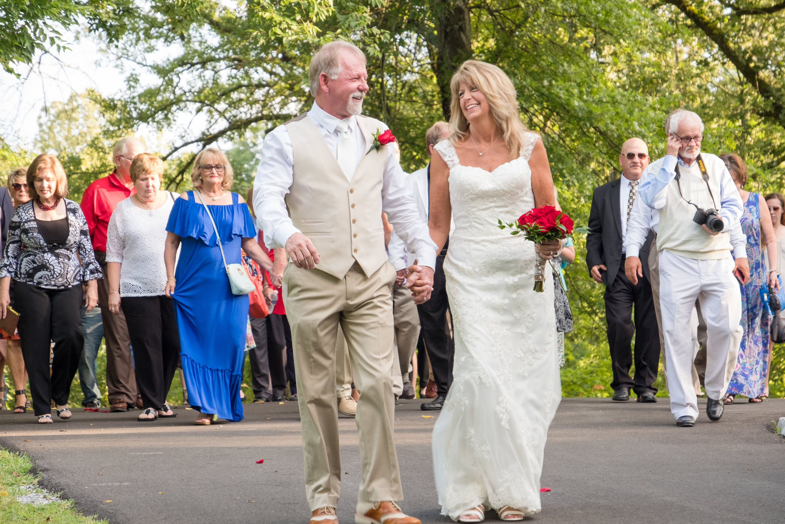 I loved Celia and Gary's idea to lead a parade of their guests to the ceremony.